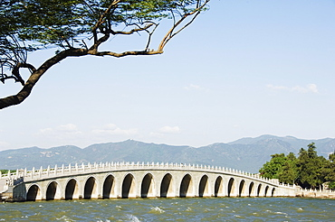 Seventeen Arch Bridge on Kunming Lake built in 1750 during Emperor Qialong's reign leads to South Lake Island, Yihe Yuan (The Summer Palace), UNESCO World Heritage Site, Beijing, China, Asia