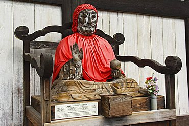 Jizo Buddha statue dressed in red cape, Todaiji (Big Buddha) Temple, constructed in the 8th century, Nara City Nara Prefecture, Honshu Island, Japan, Asia