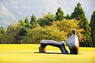A reclining bronze sculpture at Chokokunomori Sculpture Park, Fuji Hakone National Park, Kanagawa Prefecture, Honshu Island, Japan, Asia