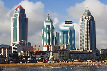Modern skyscrapers in the seaside beach resort and host of the sailing events of the 2008 Olympic Games, Qingdao, Shandong Province, China, Asia