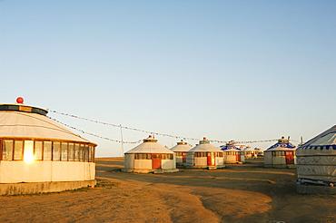 Sunrise on nomad yurt tents, Xilamuren grasslands, Inner Mongolia province, China, Asia