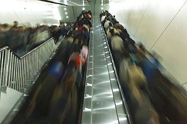 Passengers on moving on escalators on the Beijing subway, Beijing, China, Asia