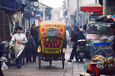 A decorated tricycle riding through the old streets of Suzhou, Jiangsu Province, China, Asia
