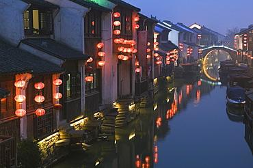 Traditional old riverside houses illuminated at night in Shantang water town, Suzhou, Jiangsu Province, China, Asia