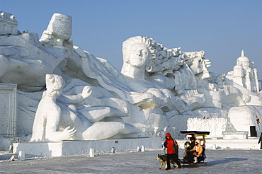A sled ride at the Snow and Ice Sculpture Festival at Sun Island Park, Harbin, Heilongjiang Province, Northeast China, China, Asia