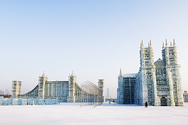 Replica ice sculptures of Notre Dame Cathedral and London's Tower Bridge at the Ice Lantern Festival, Harbin, Heilongjiang Province, Northeast China, China, Asia