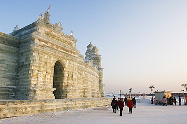 Tourists walking past the snow and Ice Sculptures at the Ice Lantern Festival, Harbin, Heilongjiang Province, Northeast China, China, Asia