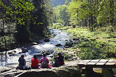 Hikers taking a break near a river, Zhangjiajie Forest Park, Wulingyuan Scenic Area, UNESCO World Heritage Site, Hunan Province, China, Asia