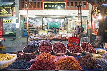 Fruit stands at a street market in the Muslim area of Xian, Shaanxi Province, China, Asia