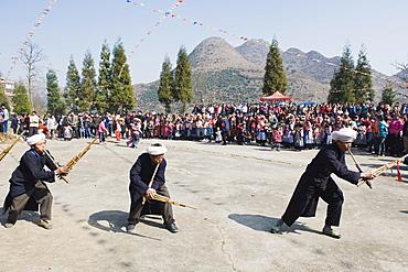 Men playing the lusheng at a 4 Seals Miao lunar New Year festival, Xinyao village, Guizhou Province, China, Asia