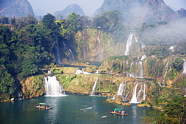 Tourist boats beneath Detian Falls, China and Vietnam transnational waterfall, Guangxi Province, China, Asia