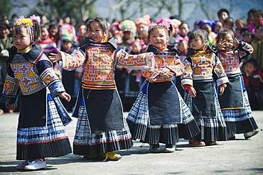 Girls in ethnic costume at a 4 Seals Miao lunar New Year festival, Xinyao village, Guizhou Province, China, Asia