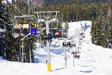 Chairlift with skiers, Whistler mountain resort, venue of the 2010 Winter Olympic Games, British Columbia, Canada, North America