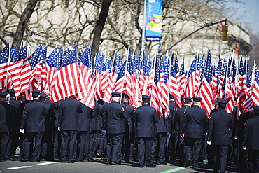 Police carrying American flags, St. Patricks Day celebrations on 5th Avenue, Manhattan, New York City, New York, United States of America, North America