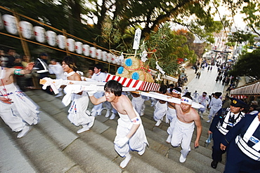 Rice bales being carried at Hadaka Matsuri (Naked Festival), Hofu city, Yamaguchi Prefecture, Japan, Asia