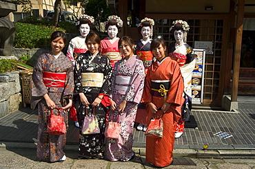Girls wearing yukata - kimono, geisha, maiko (trainee geisha) in Gion, Kyoto city, Honshu, Japan, Asia