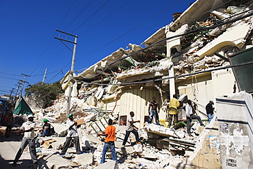 Stock being removed from The Caribbean Market, January 2010 earthquake damage, Port au Prince, Haiti, West Indies, Caribbean, Central America