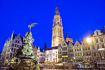 Baroque Brabo fountain, Grote Markt and tower of Onze Lieve Vrouwekathedraal, at night, Antwerp, Flanders, Belgium, Europe