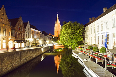 Reflection of Onze Lieve Vrouwekerk (Church of Our Lady), lit up at night, Old Town, UNESCO World Heritage Site, Bruges, Flanders, Belgium, Europe