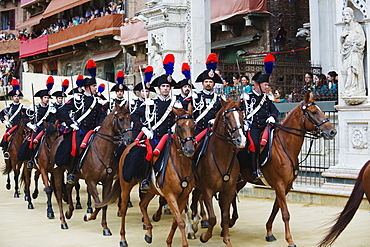 Horses and guards parading at El Palio horse race festival, Piazza del Campo, Siena, Tuscany, Italy, Europe