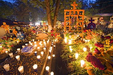 A candle lit grave, Dia de Muertos (Day of the Dead) celebrations in a cemetery in Tzintzuntzan, Lago de Patzcuaro, Michoacan state, Mexico, North America - 733-4790