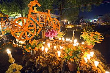 Flowers symbolizing the life of a passionate cyclist, Dia de Muertos (Day of the Dead) celebrations in a cemetery in Tzintzuntzan, Lago de Patzcuaro, Michoacan state, Mexico, North America