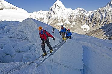 Crossing ladders in the Khumbu icefall on Mount Everest, Solu Khumbu Everest Region, Sagarmatha National Park, UNESCO World Heritage Site, Nepal, Himalayas, Asia