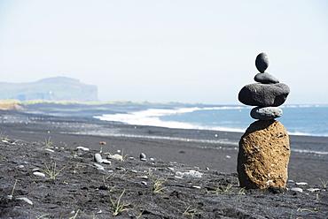 Rock piles and coastal scenery, Vik, Southern Region, Iceland, Polar Regions