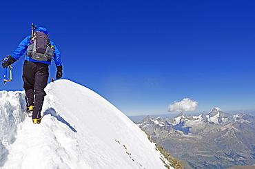 Climber on Breithorn mountain, 4164m, Zermatt, Valais, Swiss Alps, Switzerland, Europe