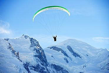 Paragliding below summit of Mont Blanc, Chamonix, Haute-Savoie, French Alps, France, Europe