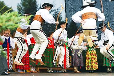 Performers in traditional costume, International Festival of Mountain Folklore, Zakopane, Carpathian Mountains, Poland, Europe