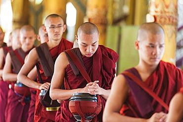 Meal time at Kha Khat Wain Kyaung monastery, Bago, Myanmar (Burma), Asia