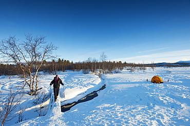 Hiker on Kungsleden (The Kings Trail) hiking trail, Abisko National Park, Sweden, Scandinavia, Europe