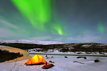 Aurora borealis (Northern lights) and winter camping on Kungsleden (The Kings Trail) hiking trail, Abisko National Park, Sweden, Scandinavia, Europe