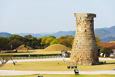 Cheomseongdae Astronomical Observation Tower, Royal Tombs burial mounds, UNESCO World Heritage Site, Gyeongju, Gyeongsangbuk-do, South Korea, Asia