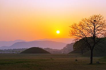 Royal Tombs burial mounds at sunrise, UNESCO World Heritage Site, Gyeongju, Gyeongsangbuk-do, South Korea, Asia