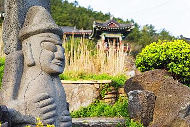 Dol hareubang (harubang) protection and fertility statue at Sanbanggulsa Temple, Jeju Island, South Korea, Asia