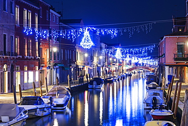 Christmas decoration on a canal at night, Murano, Venice, UNESCO World Heritage Site, Veneto, Italy, Europe
