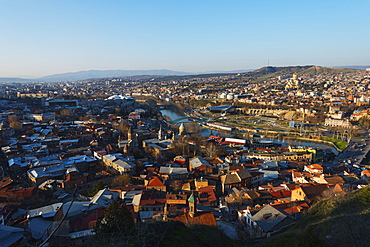 City view including Bridge of Peace on Mtkvari river, Tbilisi Sameda Cathedral and Presidential Palace, Tbilisi, Georgia, Caucasus, Central Asia, Asia