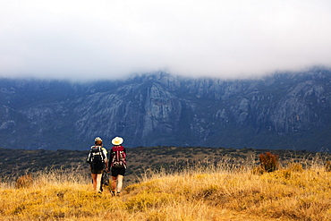 Girls hiking on a trail, Andringitra National Park, Ambalavao, central area, Madagascar, Africa