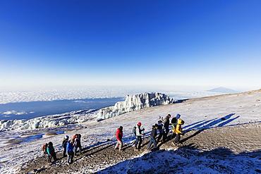 Climbers near the summit and receding glacier of Mount Kilimanjaro, Kilimanjaro National Park, UNESCO World Heritage Site, Tanzania, East Africa, Africa