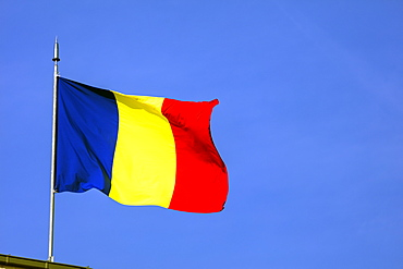 Romanian flag on top of the Arc de Triomph, Bucharest, Romania, Europe