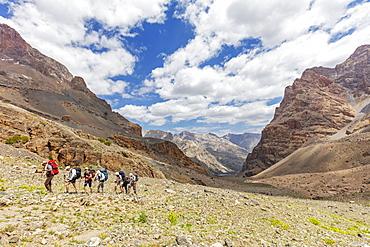 Trekkers on a mountain trail, Fan Mountains, Tajikistan, Central Asia, Asia