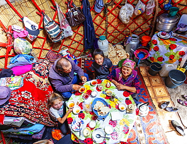 Local family in a yurt stay near Songkol lake, Kyrgyzstan, Central Asia, Asia