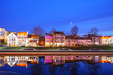 Trinity Suburb reflecting in the Svislach river, Minsk, Belarus, Eastern Europe