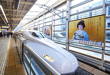 Shinkansen high speed bullet train and poster of a geisha, Kyoto, Japan, Asia