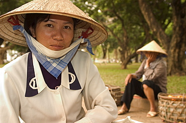 Lady wearing conical hat, Hanoi, Northern Vietnam, Southeast Asia, Asia