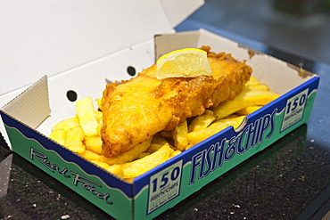Traditional British fish and chips with slice of lemon, Gloucestershire, England, United Kingdom, Europe