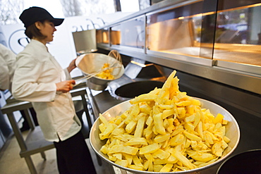 Chips being fried in traditional British chip shop, Gloucester, Gloucestershire, England, United Kingdom, Europe