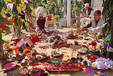 Priest with offerings at a rural Nepalese Hindu marriage ceremony, Pokhara, Nepal, Asia